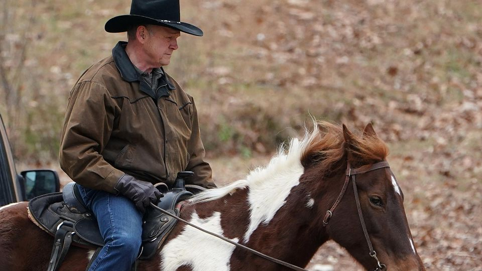 Republican Senate candidate Roy Moore arrives on his horse to cast his ballot in Gallant, Alabama, U.S., December 12, 2017.  REUTERS/Carlo Allegri