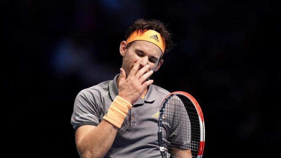 Hat sein drittes Gruppenspiel verloren: Dominic Thiem. Foto: John Walton/PA Wire/dpa