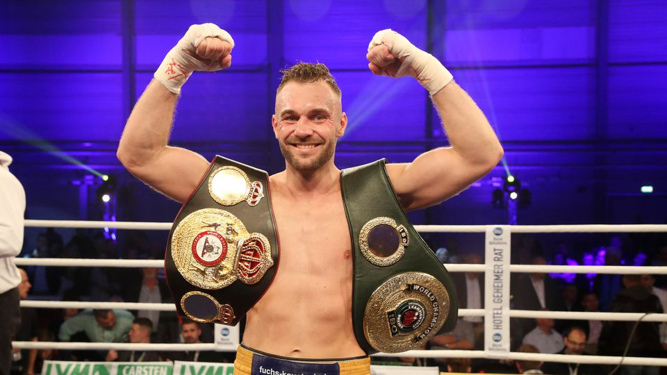191116 Dominic Bösel of Germany celebrates after winning against Swedens Sven Fornling during a boxing IBO Light Heavyw