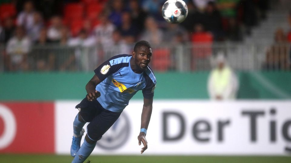 SANDHAUSEN, GERMANY - AUGUST 09: Marcus Thuram of Moenchengladbach scores his sides first goal during the DFB Cup first round match between SV Sandhausen and Borussia Moenchengladbach at BWT-Stadion am Hardtwald on August 09, 2019 in Sandhausen, Germ