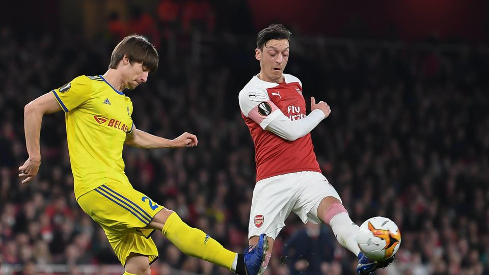 Arsenal v FC BATE Borisov UEFA Europa League Mesut Özil of Arsenal and Dmitri Baga of BATE Borisov d