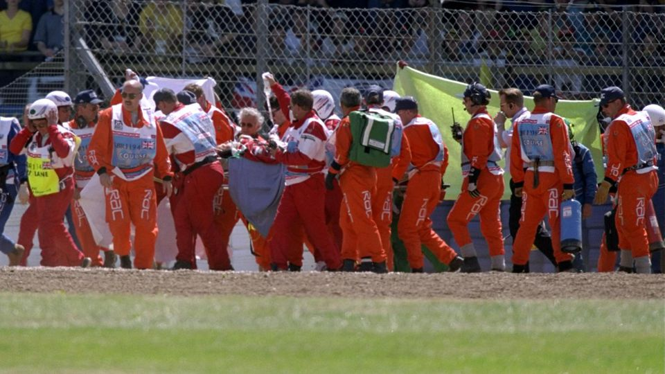 11 July 1999:  Doctors attend to Michel Schumacher of Germany and Ferrari after he hit a wall during the 1999 British Grand Prix held at SilverStone in Northampton, England.  Mandatory Credit: Andrew Redington /Allsport