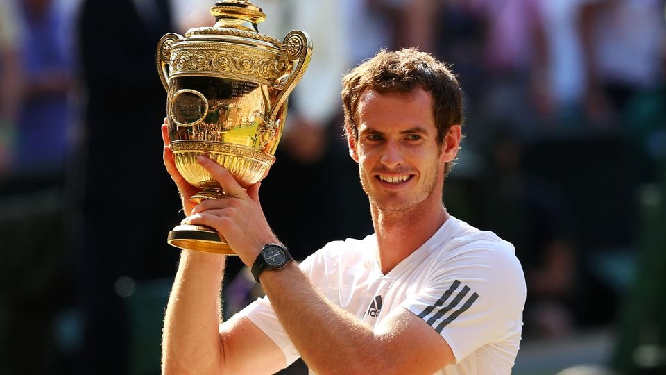 LONDON, ENGLAND - JULY 07:  Andy Murray of Great Britain poses with the Gentlemen's Singles Trophy following his victory in the Gentlemen's Singles Final match against Novak Djokovic of Serbia on day thirteen of the Wimbledon Lawn Tennis Championship