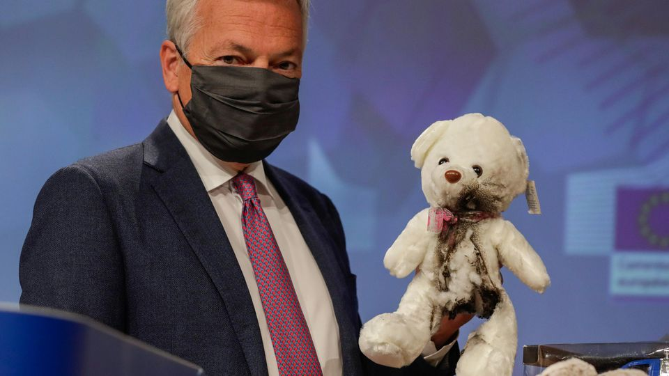 European Commissioner for Justice Didier Reynders attends a news conference in Brussels
