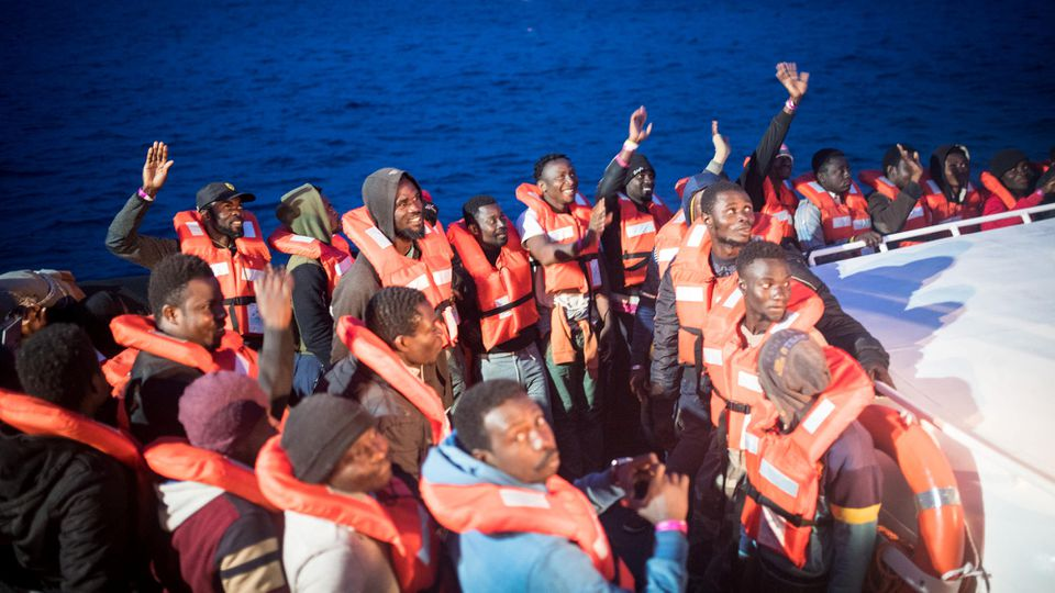 Migrants gesture as they are transferred from the Sea Watch 3 German charity ship to an Italian naval vessel heading for the island of Lampedusa, Italy May 19, 2019. Picture taken May 19, 2019. Nick Jaussi/Sea-Watch/Handout via REUTERS ATTENTION EDIT