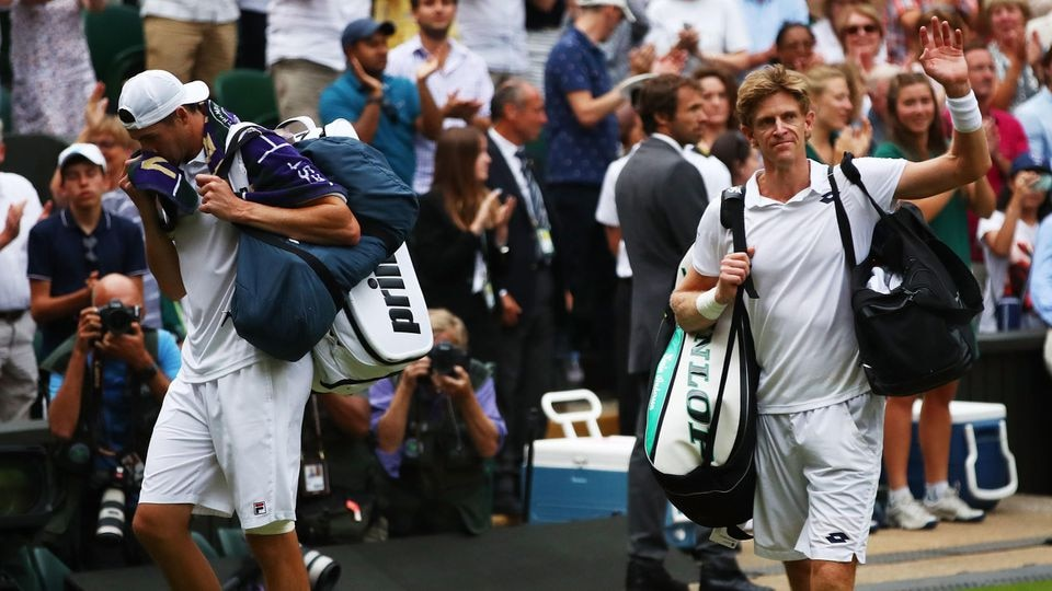 LONDON, ENGLAND - JULY 13:  John Isner of The United States (L) and Kevin Anderson of South Africa leave Centre Court after their Men's Singles semi-final match on day eleven of the Wimbledon Lawn Tennis Championships at All England Lawn Tennis and C