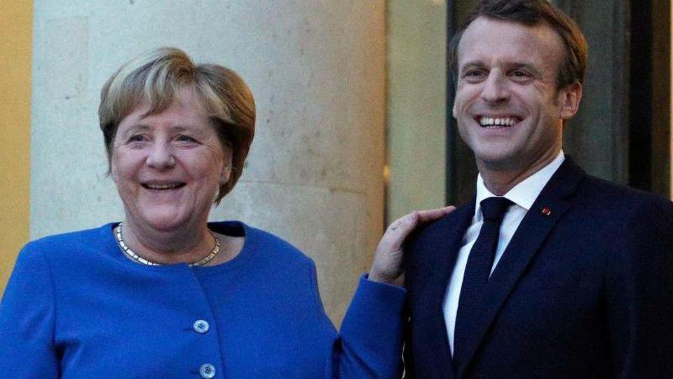 Kommen in Toulouse zusammen: Bundeskanzlerin Angela Merkel und der französische PräsidentEmmanuel Macron. Foto: Francois Mori/AP/dpa