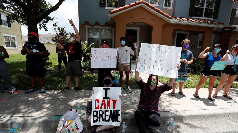 Protesters react to the news of the arrest of former Minneapolis police officer Derek Chauvin outside his Florida home, in Orlando