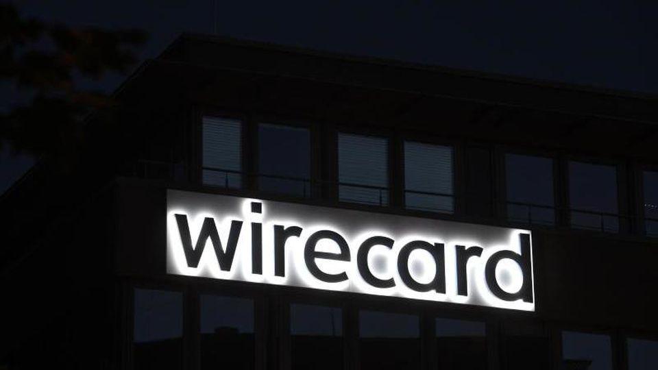 Der japanische Konzern Softbank kündigt seine Partnerschaft mit Wirecard auf. Foto: Tobias Hase/dpa