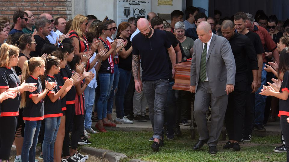 Family and friends carry the coffin of Emiliano Sala, soccer player who died in a plane crash in the English Channel, while a crowd attends his wake in Progreso
