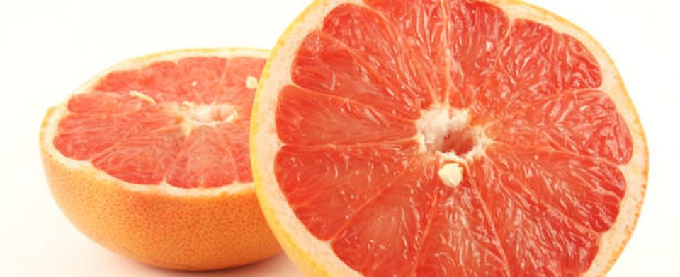 Grapefruit halves isolated on the white background