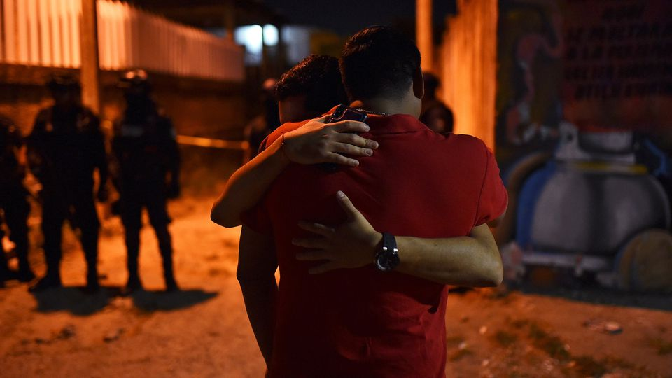 People react at a crime scene where unidentified assailants opened fire at a bar in Minatitlan in Veracruz state Mexico