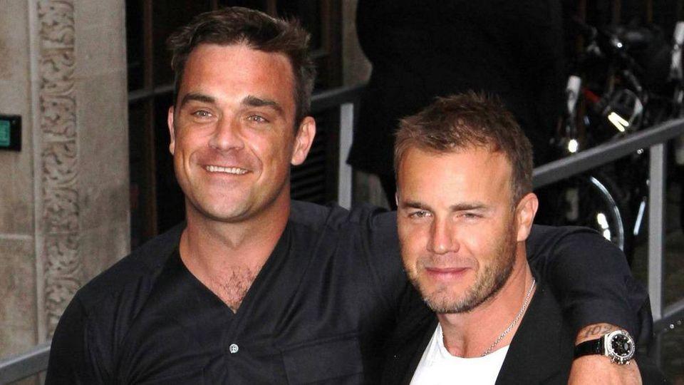 Robbie Williams (l.) und Gary Barlow kamen in der Corona-Krise mehr als einmal virtuell zusammen.