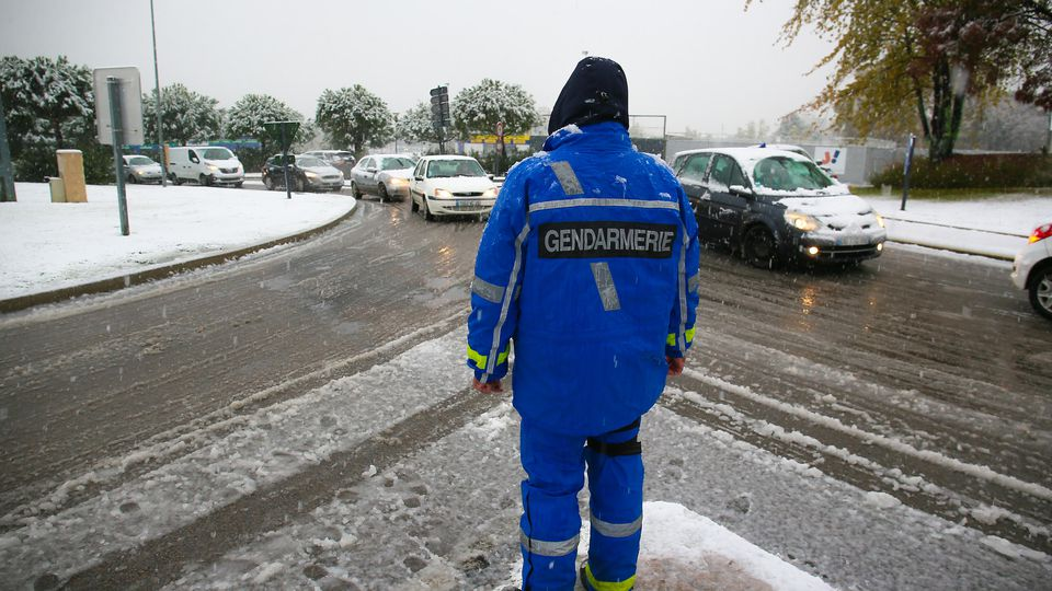 FRANCE - WEATHER - SNOW - TRAFFIC - DROME A police officer regulates traffic at the A7 motorway interchange, which is closed to heavy goods vehicles. First snowfall in the Drome which has been placed on orange alert where traffic is disrupted. Valen