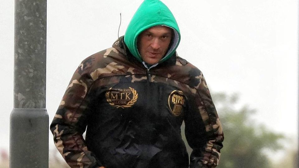 EXCLUSIVE: Raining Champion Of The World! Tyson Fury Goes For Morning Jog Despite The Wet Weather