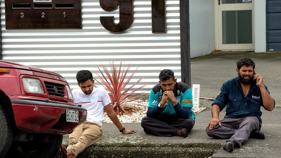 Grieving members of the public following a shooting at the Al Noor mosque in Christchurch, New Zealand, March 15, 2019. REUTERS/SNPA/Martin Hunter  ATTENTION EDITORS - NO RESALES. NO ARCHIVES     TPX IMAGES OF THE DAY