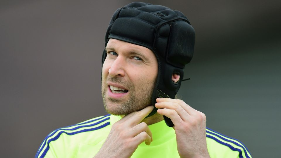 LONDON, ENGLAND - FEBRUARY 16:  Goalkeeper Petr Cech of Chelsea adjusts his protective head gear during a Chelsea training session ahead of the UEFA Champions League round of 16 match against Paris Saint-Germain at Cobham Training Centre on February