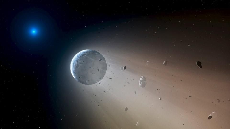 A Ceres-like asteroid is pictured slowly disintegrating as it orbits a white dwarf star in this undated handout artist's rendering in this undated handout photo obtained by Reuters October 22, 2015. Astronomers have spotted telltales signs of such an