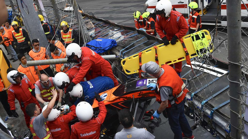 MACAO, CHINA - NOVEMBER 18: Rescuers work at the site after Sophia Flörsch (Nr. 25) crashed into a platform for media during the last day of the 65th Macao Grand Prix on November 18, 2018 in Macao, China. Five people, including two racers, got injure