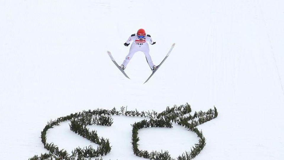 Fabian Riessle aus Deutschland springt beim Wertungssprung. Foto: Karl-Josef Hildenbrand/dpa