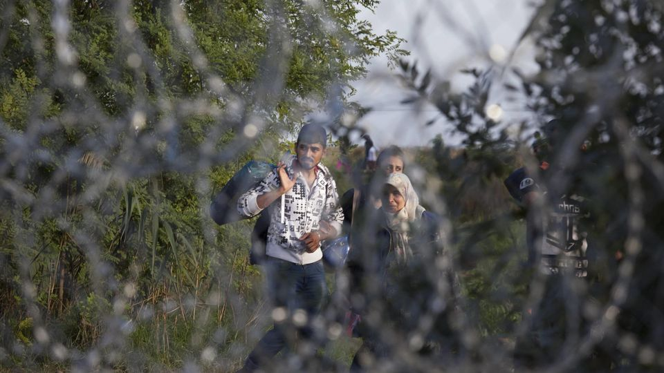 Sept. 14, 2015 - Roszke - Roszke, Hungary- September 14, 2015-- Immigrants were kept behind a barbed wire fence as Hung