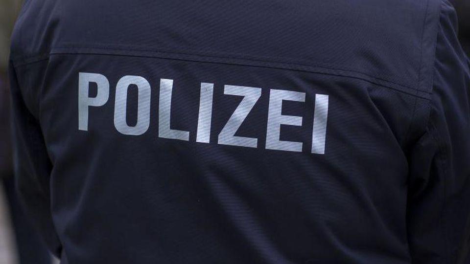 Polizist in Uniform. Foto: Jens Büttner/Archiv