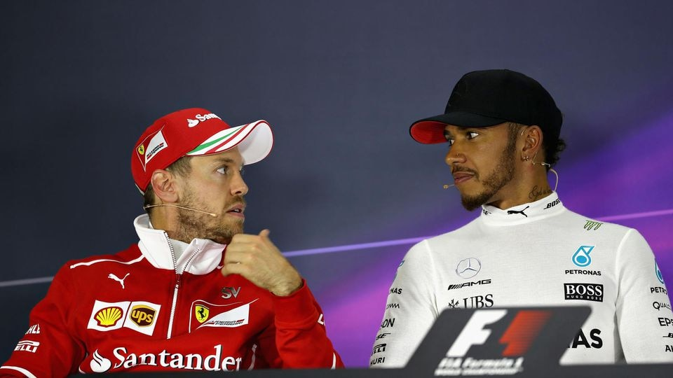 SHANGHAI, CHINA - APRIL 09:  Race winner Lewis Hamilton of Great Britain and Mercedes GP talks with second placed finisher Sebastian Vettel of Germany and Ferrari in the post race press conference during the Formula One Grand Prix of China at Shangha