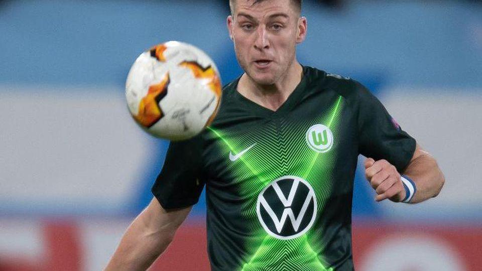 Robin Knoche im Einsatz für den VFL Wolfsburg. Foto: Swen Pförtner/dpa/archiv
