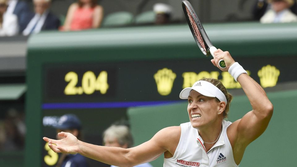 Angelique Kerber of Germany hits a return during the ladies singles quarter-final match against Daria Kasatkina of Russia at the Wimbledon Championships 2018 in London, Britain, on July 10, 2018. Angelique Kerber