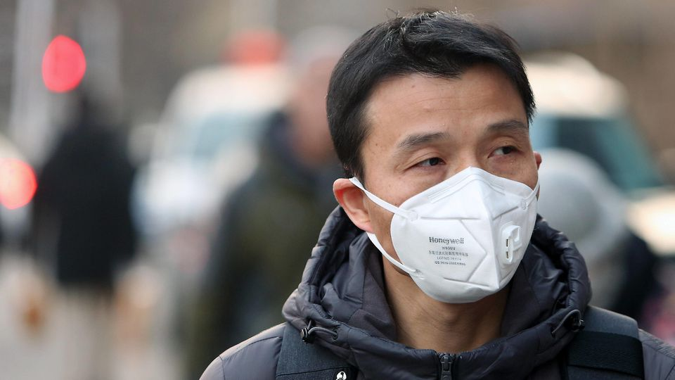 Chinese wear protective respiratory masks in downtown Beijing on Tuesday, January 21, 2020. Health authorities in China