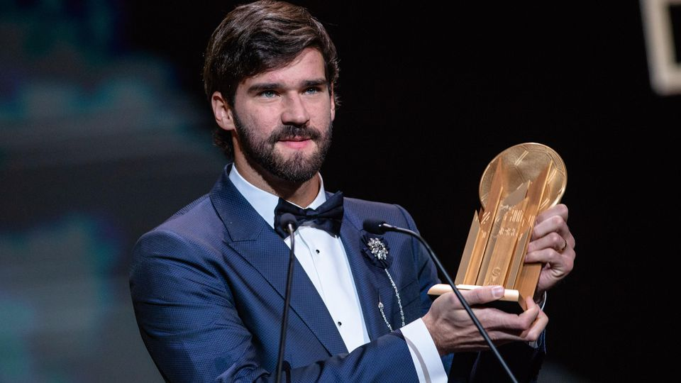 191203 -- PARIS, Dec. 3, 2019 Xinhua -- Liverpool s Brazilian goalkeeper Alisson Becker reacts after winning the Yachine trophy for best goalkeeper of the world during the Ballon d Or 2019 awards ceremony at the Theatre du Chatelet in Paris, France,