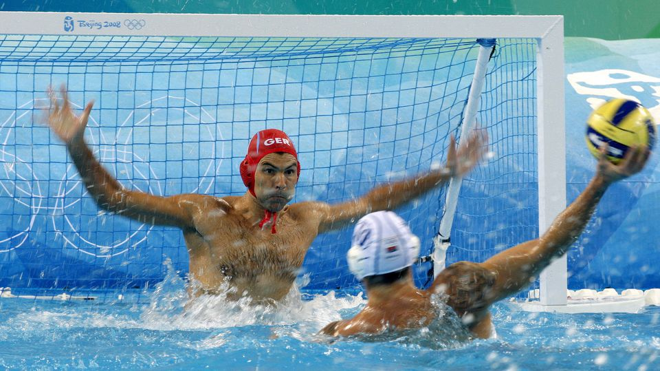 Goalkeeper Alexander Tchigir (L) of Germany vies with Aleksandar Sapic (R) of Serbia during the men's water polo preliminary round group B match 3 between Serbia and Germany competition in the Yingdong Natatorium at the Beijing 2008 Olympic Games, Be