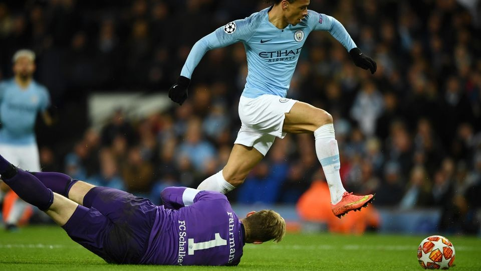 MANCHESTER, ENGLAND - MARCH 12: Leroy Sane of Manchester City takes the ball past Ralf Faehrmann of FC Schalke 04 and scores a goal which is later ruled offsideduring the UEFA Champions League Round of 16 Second Leg match between Manchester City v FC