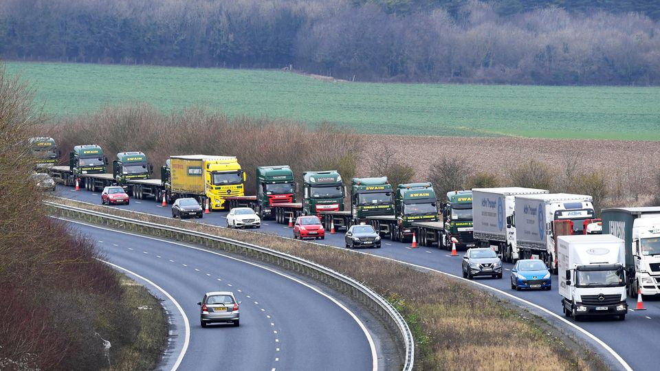 "FILE PHOTO: A line of lorries is seen during a trial between disused Manston Airport and the Port of Dover of how road will cope in case of a ""no-deal"" Brexit, Kent, Britain January 7, 2019. REUTERS/Toby Melville/File Photo"