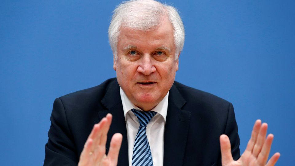 Interior Minister Horst Seehofer address the media during a news conference in Berlin