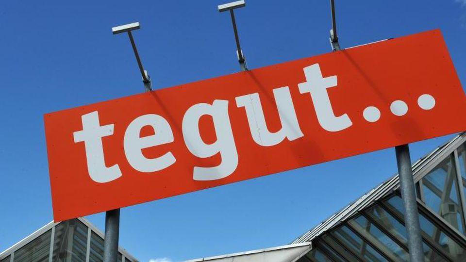 Das Logo eines tegut-Supermarkts. Foto: Uwe Zucchi/dpa/Symbolbild/Archiv