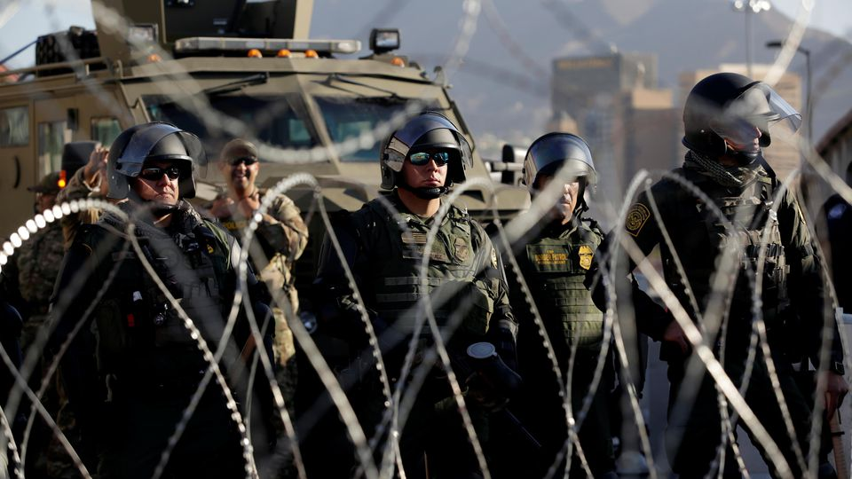 Customs and Border Protection (CBP) Mobile Field Force and Special Response Team members are seen at Paso del Norte border crossing bridge as part of the security measures put in place after migrants from Cuba protested early Monday to demand quickne