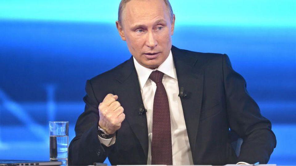 Ukraine-Konflikt: Russlands Präsident Wladimir Putin droht EU-Kommissionschef Jose Barroso.