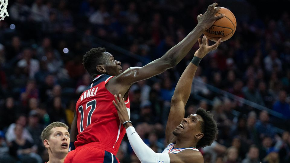 Oct 18, 2019; Philadelphia, PA, USA; Washington Wizards guard Isaac Bonga (17) blocks the shot of Philadelphia 76ers guard Josh Richardson (0) during the second quarter at Wells Fargo Center. Mandatory Credit: Bill Streicher-USA TODAY Sports