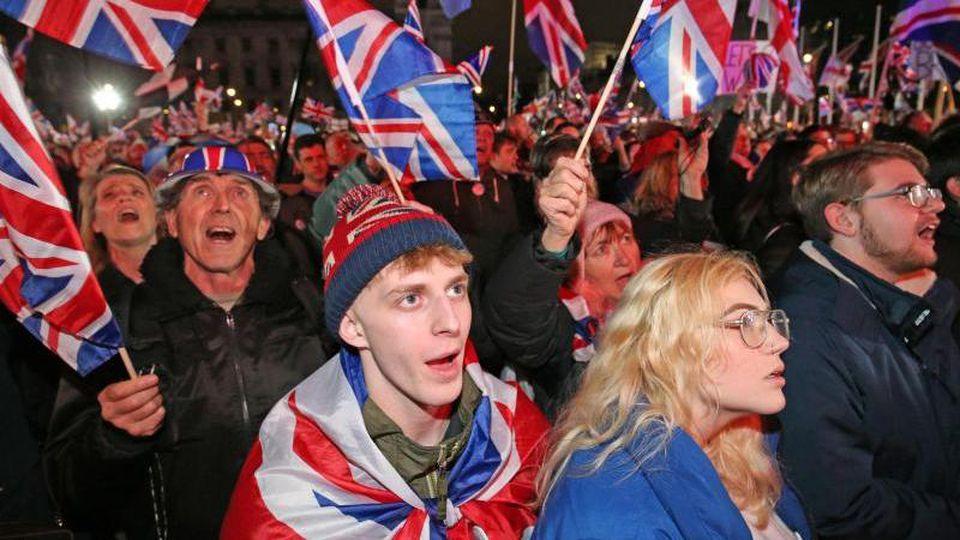 Brexit-Anhänger feiern in London das Ende der EU-Mitgliedschaft ihres Landes. Foto: Jonathan Brady/PA Wire/dpa