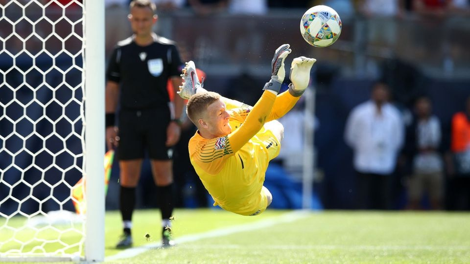 GUIMARAES, PORTUGAL - JUNE 09: Jordan Pickford of England saves the decisive penalty of Josip Drmic of Switzerland during the penalty shootout in the UEFA Nations League Third Place Playoff match between Switzerland and England at Estadio D. Afonso H