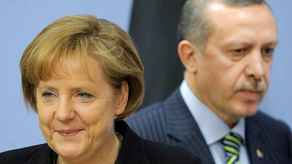 German Chancellor Angela Merkel (L) and Turkish President Recep Tayyip Erdogan (R) arrive for their press conference at the prime minister's office in Ankara, Turkey, 29 March 2010. Merkel is in Turkey on a two-days official visit. EPA/KERIM OKTEN  +