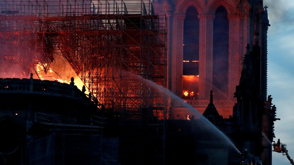 Fire fighters douse flames of the burning Notre Dame Cathedral in Paris, France April 15, 2019. REUTERS/Benoit Tessier
