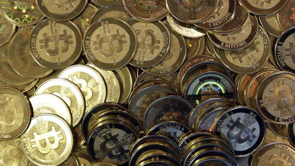 Bitcoin-Münzen. Foto: Rick Bowmer/AP/dpa