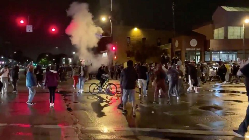 Still image shows police reportedly using tear gas and flash grenades against protesters demonstrating after the death of George Floyd in Minneapolis