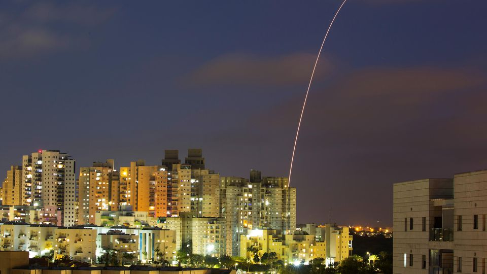 A streak of light is seen as Israel's Iron Dome anti-missile system try to intercept rockets launched from the Gaza Strip towards Israel, as seen from Ashkelon