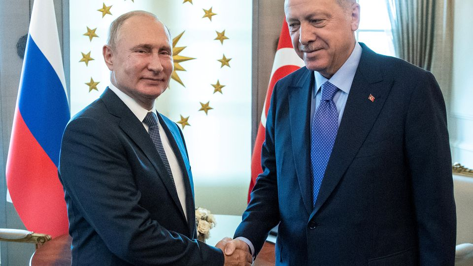FILE PHOTO: Russian President Vladimir Putin, left, and Turkish President Recep Tayyip Erdogan shake hands during their meeting in Ankara, Turkey September 16, 2019. Pavel Golovkin/Pool via REUTERS - RC19A45CE470/File Photo