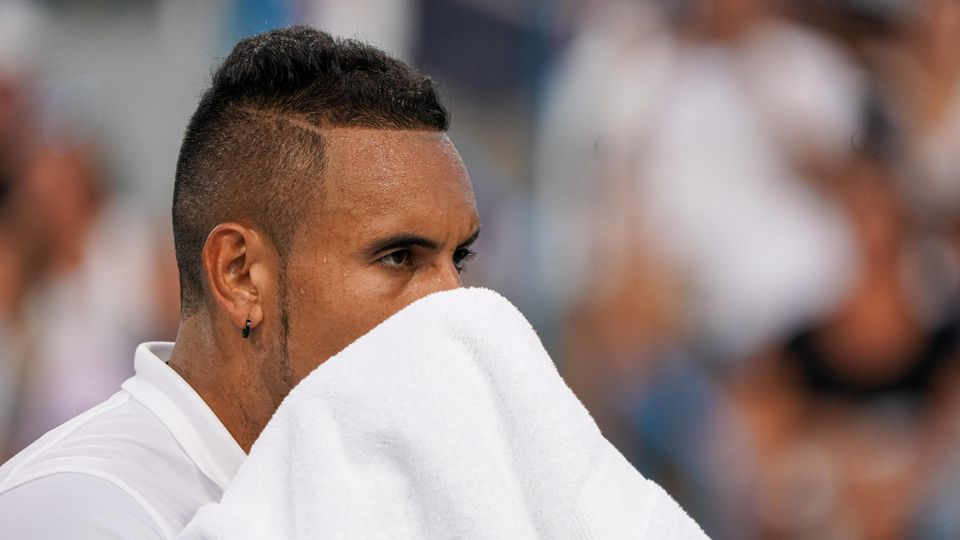 CINCINNATI OH AUGUST 12 Nick Kyrgios of Australia wipes sweat from his face during the Western