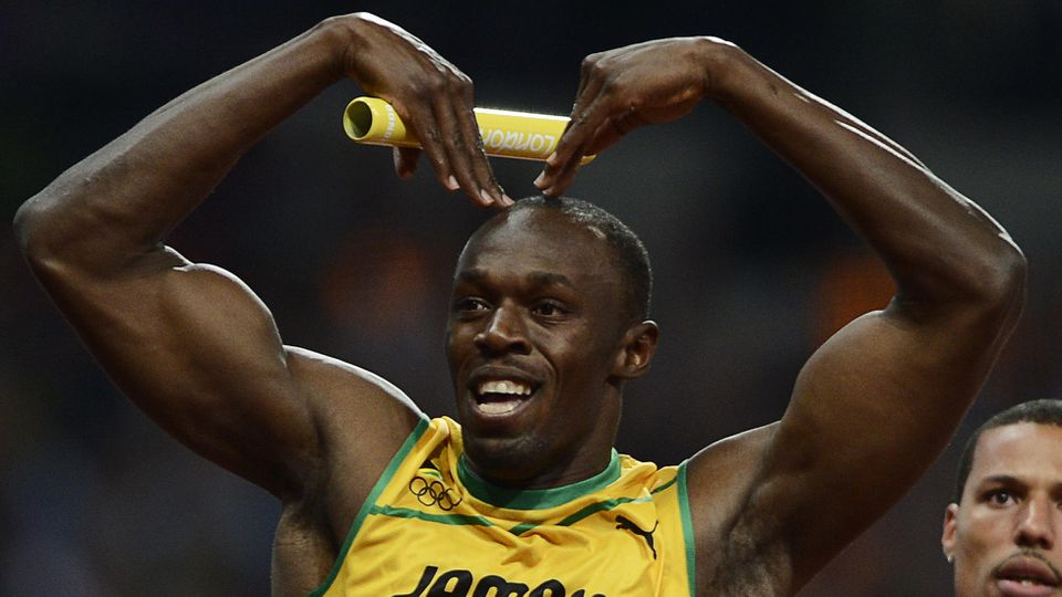 Jamaica's Usain Bolt celebrates after crossing the finish line on the anchor leg to set a world record in the men's 4x100m relay final ahead of Ryan Bailey of the U.S. during the London 2012 Olympic Games