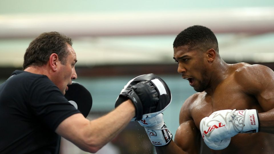SHEFFIELD, ENGLAND - OCTOBER 17: Anthony Joshua works out with his trainer Rob McCracken  during a media workout at the English Institute of Sport on October 17, 2017 in Sheffield, England. (Photo by Richard Heathcote/Getty Images)